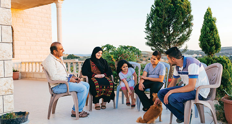 The Mardawis often sit on their porch on warm evenings. Photo by Jonas Opperskalski
