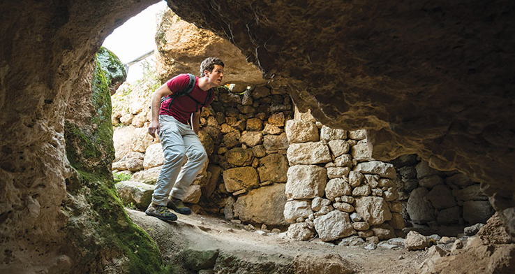 Matt Harms explores the Shepherds' Fields near Bethlehem, a site where some believe angels announced the birth of Jesus to shepherds. Photo by Frits Meyst/API