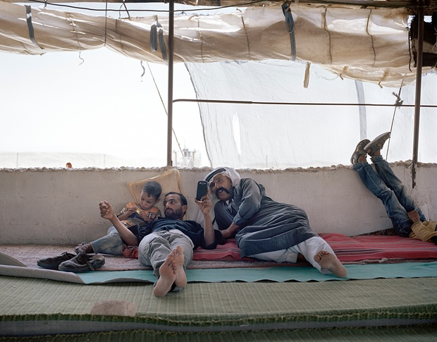 A family await a group of international tourists at their tent in Hasassa. Photograph: Maja Daniels