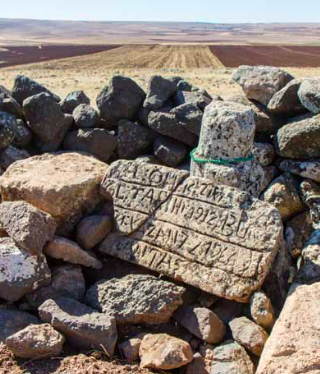 Reminders of this region's history as an important crossroads of empires lay scattered across the landscape, such as these rocks carved with ancient script.